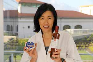 Marie Wong, head of Food Tech programme holding up food products